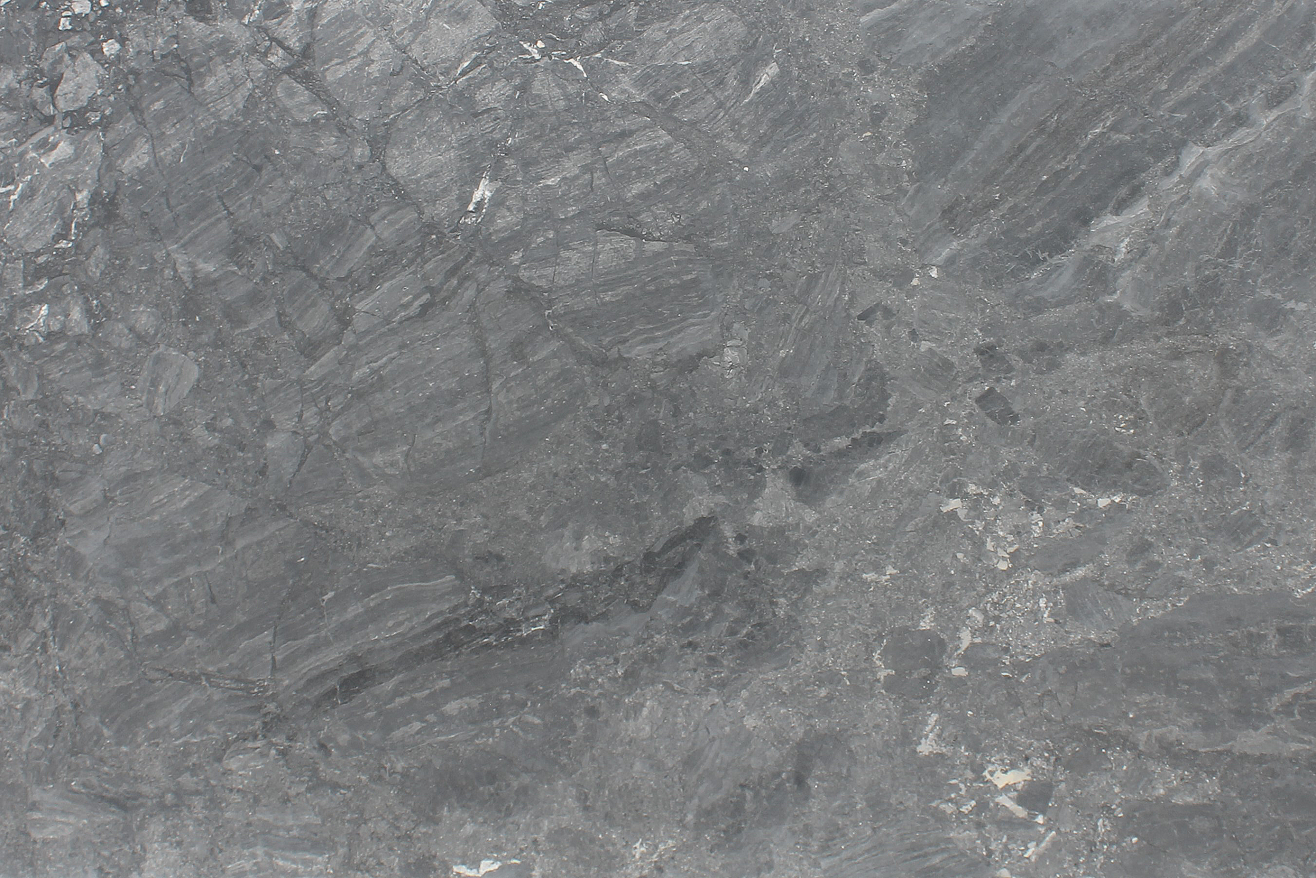 Close up picture of platinum grey honed slab in order for customers to get a better look at the stone